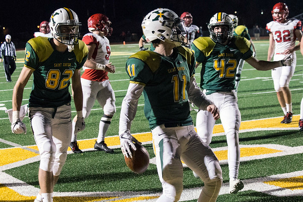 St. X QB Jack Albers had a pair of rushing touchdowns in the first half of the 6A semifinal against Scott County. 11/24/17