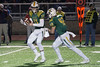 St. X QB Jack Albers hands the ball to Anthony Moretti during a 6A semifinal battle against Scott County. 11/24/17