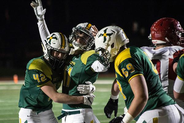 St. X QB Jack Albers celebrates his 1-yard touchdown run against Scott County in the 6A semifinal. 11/24/17