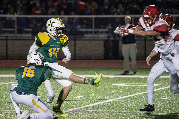 St. X kicker Alan Mateja tacks on the PAT to close out the first half of action in a 6A semifinal against Scott County. 11/24/17