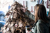 Megan Saxton checks out a Christmas tree made from recycled goods while shopping in Revelry on Small Business Saturday. 11/25/17