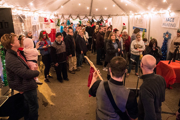 A band called Crazy Neighbors entertained the crowd in the Polar Palooza tent at the 32nd Annual Bardstown Road Aglow. 12/2/17