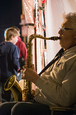 Andy Westbrook provides some seasonal tunes along the sidewalk during the 32nd Annual Bardstown Road Aglow. 12/2/17
