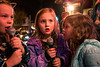 Sisters Maisie and Emilia Seifert karaoke Rudolph the Red Nosed Reindeer in front of the Doo Wop Shop during the 32nd Annual Bardstown Road Aglow on Saturday night. 12/2/17