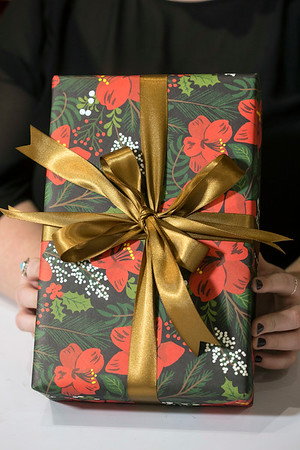 A second length of ribbon can be added to give more volume to the presentation of a wrapped gift. 12/6/17.