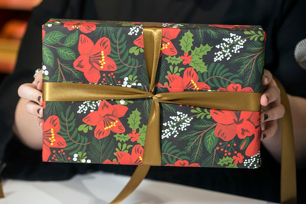 A criss-cross pattern on the front of a package is made by twisting the ribbon and wrapping it around all sides of the box. 12/6/17