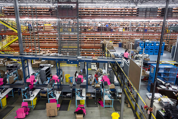 A conveyor belt moves boxes above sorting stations at Radial Fulfillment & Distribution. 12/8/17