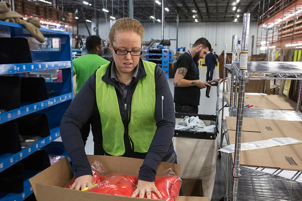 Brittany Hammonds prepares merchandise to be shipped from the Radial Fulfillment & Distribution in Bullitt County. 12/8/17