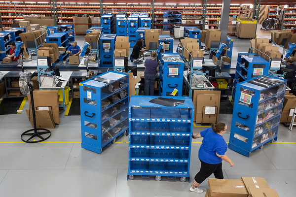 Employees at the Radial Fulfillment & Distribution facility are surrounded by boxes that are constantly being prepared to ship out. 12/8/17