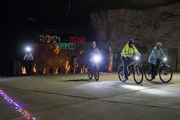 Riders emerge from the dark around the midpoint of a 1.2 mile course in the Louisville Mega Cavern on Saturday. 12/9/17