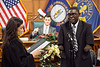 Judge Jessica Moore swears in Vitalis Lanshima as the Louisville Metro Council replacement for Dan Johnson in District 21 on Thursday night. 12/14/17