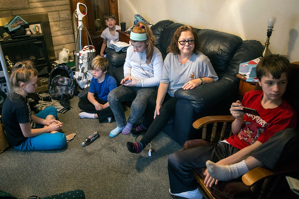 Brenda Nichols sits surrounded by the five grandchildren she is raising in her Valley Station home. 12/22/17