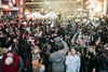 Revelers celebrate in a storm of confetti with midnight kisses and hugs throughout the crowd at Fourth Street Live. 12/31/17