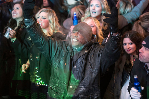 Happy faces warmed the scene as thousands gathered to celebrate the end of 2017 at Fourth Street Live on Sunday night. 12/31/17