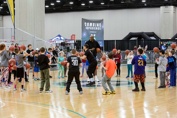 Dozens of boys and girls surround former UofL basketball player and PRP grad Terrance Farley during a skills clinic at Sports Fest in the South Wing of the Kentucky Expo Center on Sunday afternoon. 1/7/18