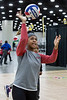 Male High School's Kylie Newby demonstrates the proper way to serve a volleyball during Sports Fest. 1/7/18