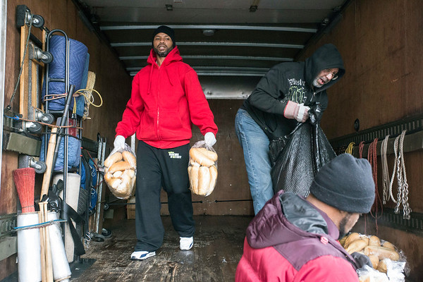 A truck of donated food items from Barry's Cheesesteaks on Preston Highway is unloaded at the East Jefferson Street Wayside Christian Mission on Friday morning. 1/12/18