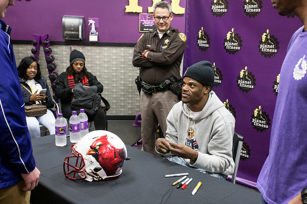 Heisman winner Lamar Jackson meets his fans and signs memorabilia during an autograph session at the Planet Fitness in Okolona. 1/13/18