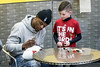 UofL fan Dalston Link brought a football for Heisman winner Lamar Jackson to sign during an autograph session at Planet Fitness on Saturday afternoon. 1/13/18