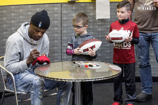 Blake Roberts and Dalston Link met UofL quarterback Lamar Jackson in a special VIP section during an autograph session at Planet Fitness on Saturday. 1/13/18