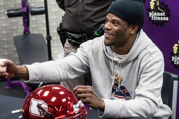 UofL quarterback Lamar Jackson shakes hands with fans during his autograph session at Planet Fitness on Saturday afternoon. 1/13/18