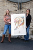 Jeaneen Barnhart and Doreen Barnhart-DeHart stand with a sample print of their 2018 Kentucky Derby Festival poster design. The sisters check to see how their design looks under outdoor light when tweaking the final print version. 1/25/18