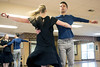 Ryan Devlin spins with dance instructor Jennifer Henderson during a Tuesday morning rehearsal at Derby City Ballroom. 1/30/18