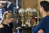 Dance instructor Jennifer Henderson shows off the collection of competition trophies at Derby City Ballroom to student and actor Ryan Devlin. 1/30/18