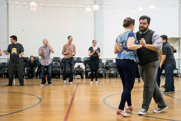 Patrick Draus and Emily Schuhmann get the action started during a swing dance class at Highlands Community Ministries on Tuesday night.  1/30/18