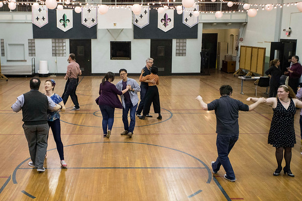 The gymnasium at Highlands Community Ministries comes alive on Tuesday nights as students in a swing class learn and practice classic dance moves. 1/30/18