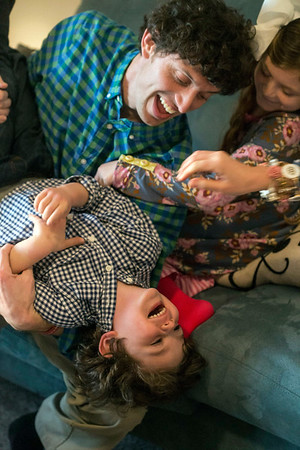 Henry Bischoff can't help but laugh when the family moves in on a group tickle attack. 2/8/18