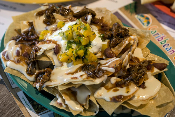 The Caribbean nachos at Naila's Caribbean Cuisine come with homemade tortilla chips, red beans, freshly prepared house made mango salsa and is drizzled with queso. 2/14/18