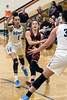 PG Emma Ralph of Bullitt East drives against Mercy defenders during the 24th District Final on Thursday night. 2/22/18
