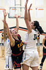Lexi Taylor of Bullitt East was met with force by Mercy's Danielle Feldkamp during the 24th District Final on Thursday night. 2/22/18