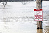 A sign in Veterans Memorial Park in West Point is almost water level as the town nestled between Dixie Highway and the Ohio River experiences flooding from recent rain. 2/25/18