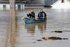 West Point business owners Norm and Mike Bickel row along flooded streets on Sunday afternoon to check on several properties the brothers own in the small town 40 minutes south of Louisville.. 2/25/18