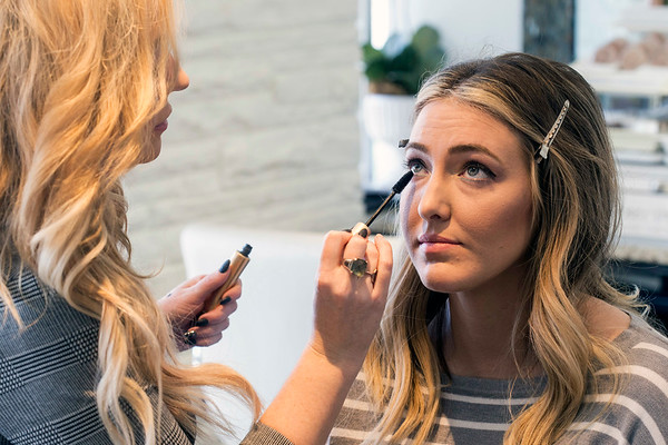 Lash conditioner is applied by stylist Jill Higginbotham to keep mascara in place when tending to eye lashes. 2/27/18