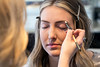 Rose gold eyeshadow is applied as the next step in stylist Jill Higginbotham's make-up process. 2/27/18