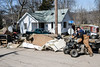 Mounds of carpeting, dry wall and other flood damaged property formed mounds along Elm Street in West Point, KY on Saturday as residents began the process of cleaning up Mother Nature's mess. 3/3/18