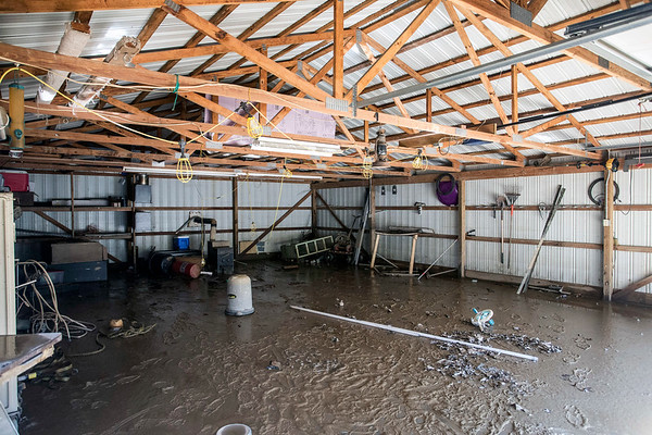 Adam Johnson's garage in West Point, KY was muddied up and occupied by a few snakes after floodwaters receded. 3/3/18