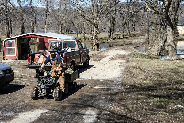 West Point, KY native Chris Hodge used one of the few passable roads to get back and forth between Elm Street and Riverview Road during the community's Saturday clean-up efforts after floodwaters overtook the small town. 3/3/18
