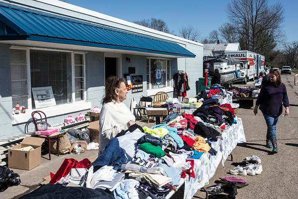 Donated clothing lined the street in West Point, KY on Saturday as residents affected by recent floodwaters worked to clean the small town back up.