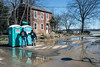 Clean up crews rely on portable facilities as the community of Utica, Indiana tended to the mess of recent floodwaters on Sunday. 3/4/18
