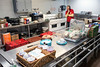 Red Cross workers manage a kitchen in the Utica, Indiana community center on Sunday providing food to flood victims. 3/4/18
