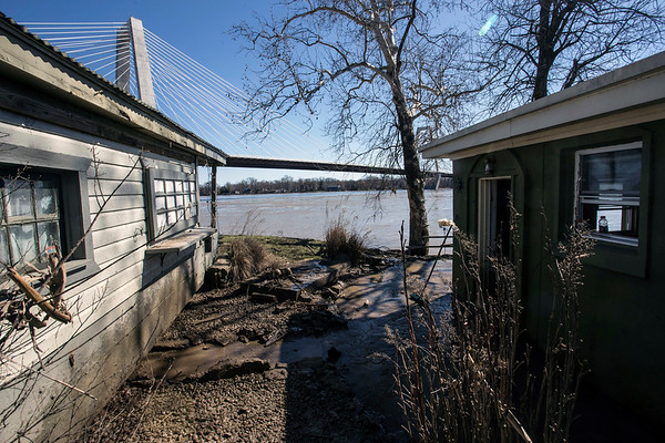 The home of Chase Johnson in Utica, Indiana came dangerously close to being hit by a shanty he also owns when it was lifted by floodwaters and moved several yards. 3/4/18