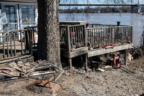 A deck on Upper River Road in Utica, Indiana sits snarled with twisted driftwood and tossed property from last week's floodwaters. 3/4/18