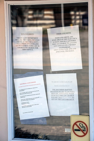 Public information was plastered on the door to the community center in Utica, Indiana as flood victims coped with Mother Nature's mess on Sunday. 3/4/18