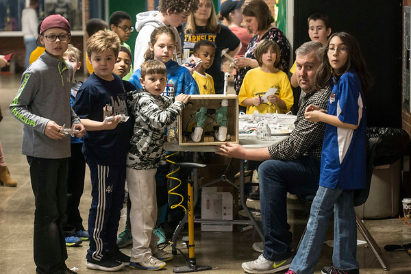 Students enjoy launching rockets at an angle in the Moore High gym on Saturday during the KDF RoboRumble Regional Robot Competition. 3/10/18