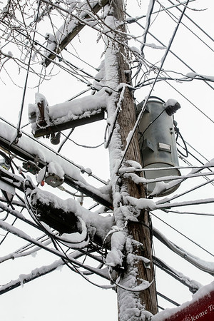 Powerlines along Burnett Avenue carried the weight of several inches of snow on Wednesday. 3/21/18