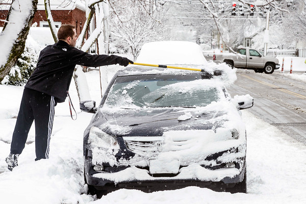Louisvillians were burdened with extra car maintenance on Wednesday morning as several inches of snow covered the city between Tuesday afternoon and Wednesday morning. 3/21/18